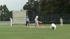 a cricket batsman plays a defensive shot in a grade level match in sydney, australia