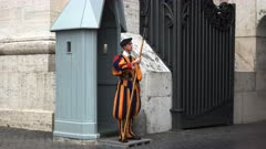 a swiss guard on duty at saint peter's square in rome, italy