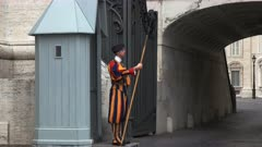 side view of a swiss guard on duty at saint peter's square in rome, italy