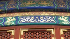 panning shot of dragon and phoenix gilded artwork on walls of the temple of heaven in beijing, china