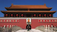 a police officer stands on duty at the entrance to the forbidden city at tiananmen square, beijing china