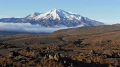 an early morning tilt up shot of mount ngauruhoe from the tongariro circuit, new zealand