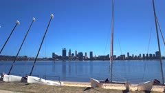 morning view of the skyline of the city of perth and catamarans for hire on swan river, western australia