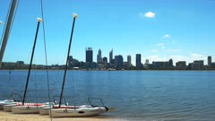 catamarans for hire on the swan river and the skyline of the city of perth, western australia