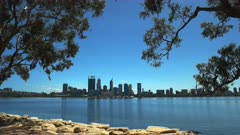 perth skyline framed by gum trees and the swan river, western australia