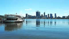 morning view of the skyline of perth and a paddle steamer on the swan river, western australia