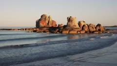 a view of beach and the granite picnic rocks on the east coast of tasmania, australia