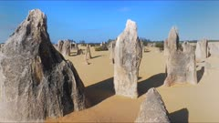 a day time 3 axis gimbal shot walking between pinnacles in nambung national park, western australia