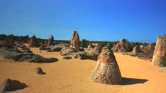 3 axis gimbal shot walking towards a group of pinnacles in nambung np, western australia