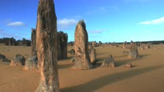 gimbal shot walking between western australia's pinnacles at dusk