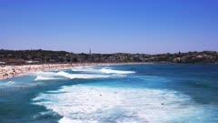 wide angle shot of surfers at bondi beach in sydney, australia