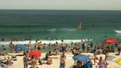 swimmers and beach goers at bondi beach, australia's most famous beach