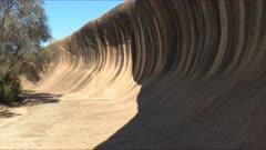 a tilt up shot of wave rock near hyden in western australia