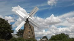 an operating windmill at oatlands in tasmania, Australia with its sails turning