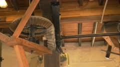 wooden gears turning in a working windmill at oatlands in tasmania, australia