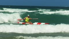 close up of the winner of a surf life saving men's surf ski race on the sunshine coast of australia
