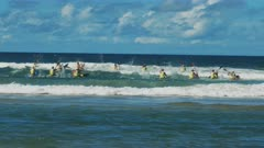 wide shot of the start of men's surf ski race during a surf life saving carnival on the sunshine coast of australia