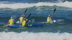 close up of  competitors paddling out through the waves in a men's surf ski race on the sunshine coast of australia