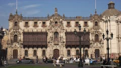 wide view of the exterior of the archbishop's palace at the plaza mayor in lima, peru