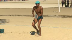 a male player practices for a beach tennis game on copacabana beach in rio de janeiro, brazil