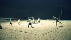 night time shot of a beach tennis game on copacabana beach in rio de janeiro, brazil