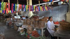 peruvian women selling bread at san pedro market in cusco, peru