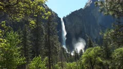 slow zoom in on a sunlit bridalveil falls in yosemite national park, california