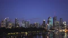 panning view of the skyline of brisbane in australia at dawn