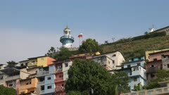 close up of cerro santa ana lighthouse and colorful houses in guayaquil, ecuador