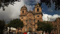 the jesuit church of the society of jesus in cusco framed by trees