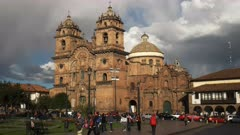 afternoon wide angle view of the church of the society of jesus in cusco, peru