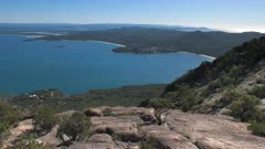 a view of the popular holiday town of coles bay from mt amos on the east coast of tasmania, australia