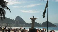 replica of christ the redeemer statue on copacabana beach in rio de janeiro, brazil