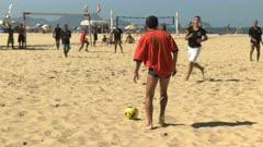 a player takes a free kick in a beach soccer game on copacabana beach in rio de janeiro, brazil