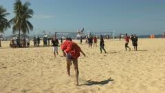 beach soccer player takes a shot on goal on copacabana beach in rio de janeiro, brazil