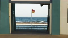 surf life saving flag and swimmer at the ocean baths in newcastle, australia