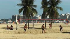 wide shot of a footvolley game on copacabana beach in rio de janeiro, brazil