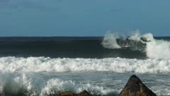 tracking shot of a man surfing at snapper rocks on the gold coast