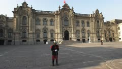 side on view of government palace and guards on duty at plaza mayor in lima, peru
