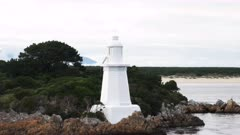 beacon light at hells gates in the entrance to macquarie harbour in tasmania, australia