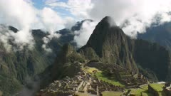 slow zoom in of peru's famous lost inca city of machu picchu on a misty morning