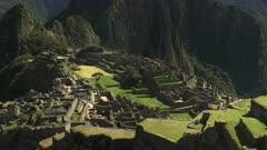 tilt up shot of peru's famous lost inca city of machu picchu on a misty morning