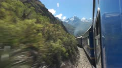 the view from the window of a peru rail train from machu picchu to ollantaytambo