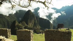 peru's machu picchu ruins and stone wall on a misty morning