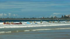 close up of a men's surf boat crew starting a race on the sunshine coast of australia