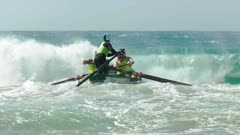 close up of the henly surf boat crew racing in the national championships on the sunshine coast of australia