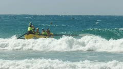 the view from the beach of a surf boat race at alexandra headland on the sunshine coast of australia