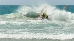 a cheeky clip of a surf boat crew waiting for the start of a race on the sunshine coast of australia