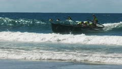 close up surf boat race finishing a race at alexandra headland on the sunshine coast of australia