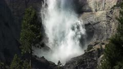 close up of water crashing into the base of the first section of yosemite falls in yosemite national park
